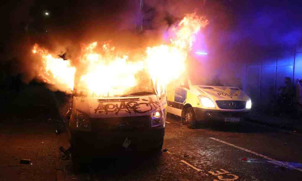 A vandalised police van on fire outside Bridewell police station in Bristol. Photograph: Andrew Matthews/PA